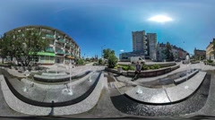 360Vr Video Tourist is Sitting by a City Fountain Backpacker Cityscape Cars Are Stock Footage