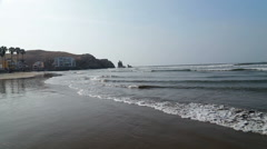 Pacific ocean washing the shore of small town in Peru Stock Footage