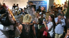 Men dance with Bible scrolls during the ceremony of Simhath Torah Stock Footage