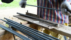 Workers bending steel for use in construction. Stock Footage