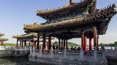 Walking towards the Five Dragons Pavilions in Beihai Park, Beijing, China Stock Footage