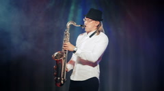 Man playing the saxophone on stage Stock Footage