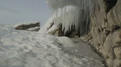Huge icicles on rocks Stock Footage