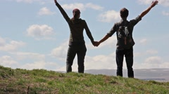 Couple holding hands and then disperses in different directions Stock Footage