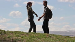 Man and woman  goes to each other, then hug, then look on mount Elbrus Stock Footage