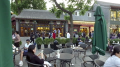 Panning view of customers have cafe at Lotus Market near Houhai Lake Stock Footage