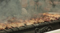 Shish kebab cooking on an outdoor grill Stock Footage