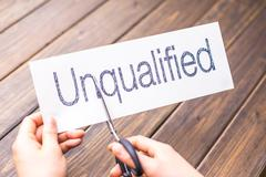 Unqualified to qualified on paper by scissors Stock Photos