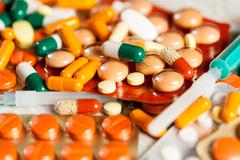 Medicine prescription. Pills and antibiotic in blurred background Stock Photos