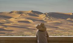 Caucasian woman admiring sand dunes in desert landscape Kuvituskuvat