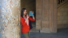 Young woman filming video with smartphone of old building, super slow motion - stock footage