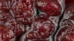 Red jam strawberry close up. Loop rotation Stock Footage