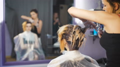 A radical change of hair color. Attractive blonde woman in a beauty salon Stock Footage