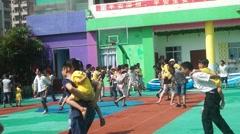 Shenzhen, China: kindergarten children and their parents together Stock Footage