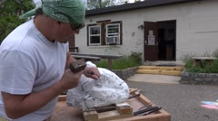 The artist creating sculpture of stone  on the yard of art gallery. Stock Footage