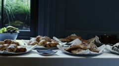 Lunch snacks on white table beside window Stock Footage