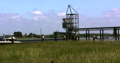 Loading a Rhine barge with sand using a conveyor Stock Footage