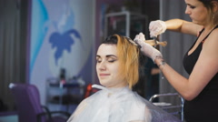 Professional hair color in the beauty studio - stock footage