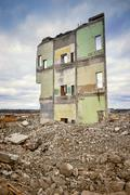 Pieces of Metal and Stone are Crumbling from Demolished Building Stock Photos