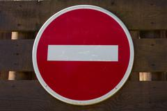 No entry sign in front on a wooden background - stock photo
