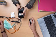 Woman paying the doctor with credit card flat lay Kuvituskuvat
