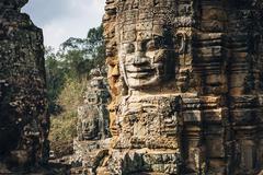 Dilapidated statue and pillar at Angkor Wat, Siem Reap, Cambodia Stock Photos