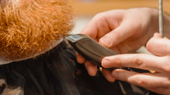 Professional barber cutting beard of a pleasant man - stock footage