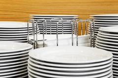 Buffet platters stacked around napkin display - stock photo