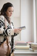 Woman shopping for books in bookstore Stock Photos