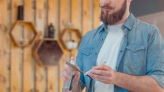 Professional barber disinfecting his instruments - stock footage