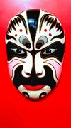 Chinese Traditional Opera Mask on red background Stock Photos