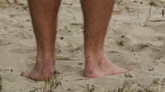 Feet standing on sand Stock Footage
