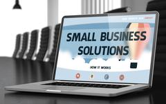 Small Business Solutions on Laptop in Conference Hall Piirros