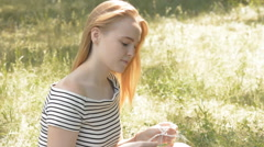 Young woman with headphones outdoors in the par - stock footage