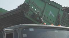 Potato harvester on conveyor belt delivers crop in truck Stock Footage
