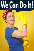 rosie riveter cleaning gloves cloth - stock photo