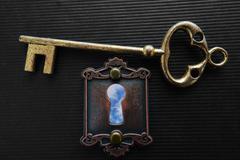 Blue sky keyhole Stock Photos