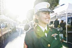Asian soldier smiling in farmers market Kuvituskuvat