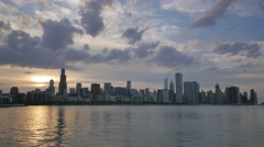Chicago Skyline Reflected on the Lake at Sunset - stock footage