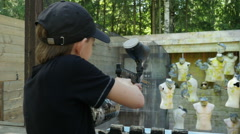 A boy practicing paintball shooting to the target in a shooting range, Full HD Stock Footage