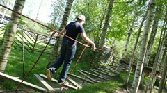 Young boy climbing up the rope ladders in the adventure park, Full HD shot - stock footage