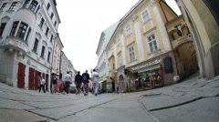 Tourists and citizens on one of the pedestrian streets of Bratislava, fisheye Stock Footage