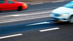 Cars going along the crossroads at dusk - stock photo