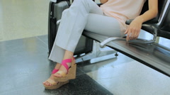 Young woman waiting for her flight at the International Airport. Stock Footage