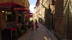 Walking in medieval streets of Volterra town, Tuscany, Italy. POV, steadicam. Stock Footage