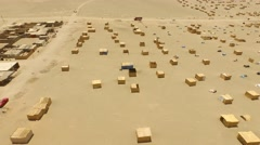 Land occuption: Aerial of Huts in a desert Stock Footage