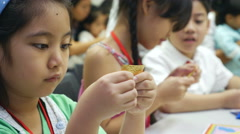 4K : Asian child learning to folding Japanese paper origami Stock Footage