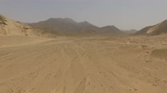 Aerial of sand dunes in a desert in Peru, South America Stock Footage
