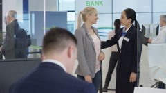 4K Modern city bank, man talking to customer & giving good news Stock Footage