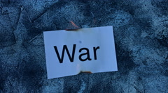 4k shoot of a creative composition with war word on fire Stock Footage
